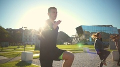 A group of young friends doing high knees exercise outdoors slow motion Stock Footage