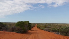 Red sand outback 4x4 road in Australia Stock Footage