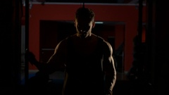 Young man doing workout in gym Stock Footage