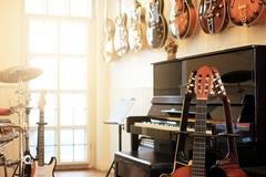 Musical instruments. Electric guitars, Piano, Drums Stock Photos