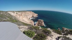 Boardwalk over steep red sea cliffs of Kalbarri NP in Australia Stock Footage