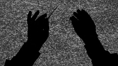 Silhouette tv noise orchestra leader hands Stock Footage
