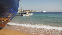 Beach in Egypt. Resort Red Sea Coast. Coast guard boat near the seaport Stock Footage