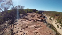 Red rocks over almost dry Murchison River bed in Kalbarri NP Stock Footage