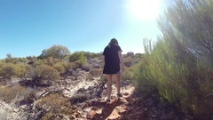 Girl walking in sunny dry outback in Kalbarri NP Stock Footage