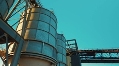 Gimbal shot showing large cisterns of an industrial facility processing ballast Stock Footage