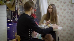 Nice couple of young people in the cafe talk. Girl smiling at her boyfriend, she Stock Footage