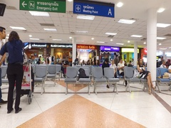 People sitting and waiting for family to arrive at airport Stock Footage