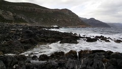 Black rocks at the coast of Ano Kastania Stock Footage