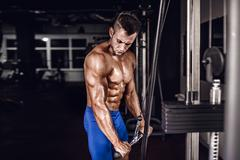 Young Bodybuilder Doing Heavy Weight Exercise For Triceps Stock Photos
