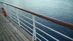A lifesaver attached to the side rail on board a sailing cruise ship in French P Stock Footage