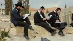 JERUSALEM, ISRAEL -  A group of American Orthodox Jewish read Stock Footage