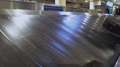 The conveyor belt baggage claim at the airport. Receipt of baggage. Airport Stock Footage
