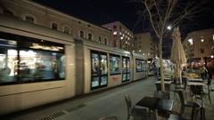 JERUSALEM, ISRAEL - Light Rail tram train on Jaffa road in Stock Footage