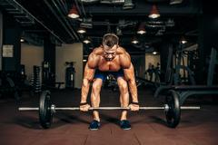 Young shirtless man doing deadlift exercise at gym. motivation Stock Photos