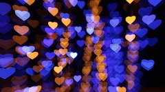 Abstract background with colored lights in the shape of hearts Stock Footage
