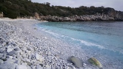 Beach with white stones in Exo nimfio Stock Footage