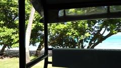 A tour truck driving around the island of Bora Bora, French Polynesia, slow moti Stock Footage