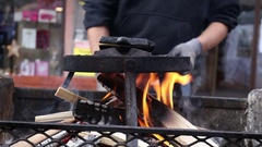 Cooking traditional hot waffles using old fashioned waffle iron charcoal Stock Footage