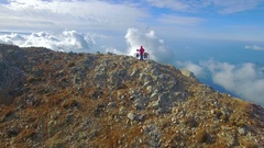 Cyclist Peak Of The Mountain Stock Footage