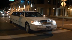 Limo limousine city night driving Stock Footage