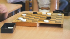 Children play checkers at a kindergarten. Close-up Stock Footage