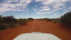 POV 4x4 vehicle driving on red earth sand road in Australia Stock Footage