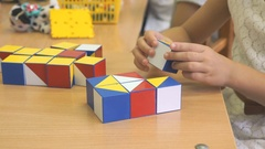 Child collecting a pattern using colored cubes Stock Footage