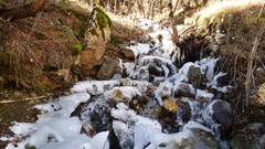 Stream with ice in Mavrovo National Park Stock Footage