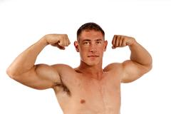 Man Flexing Muscles Stock Photos
