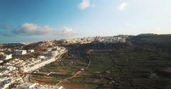 Aerial shot approaching a church in Mellieha Malta Stock Footage
