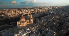 Aerial shot around a church in Mellieha Malta Stock Footage