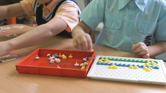 Children collecting a pattern using colored chips Stock Footage
