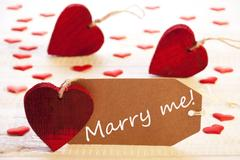 Label With Many Red Heart, Text Marry Me Stock Photos