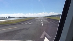 Airplane on runway starting to take off for flight over South Pacific ocean. Stock Footage