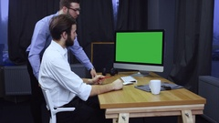Two developers working on a project at start up office, discussing project Stock Footage