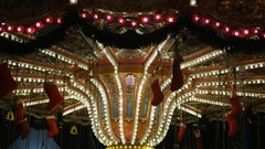 Iluminated carousel at night Stock Footage