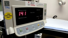Blood pressure monitoring machine at a hospital clinic Stock Footage