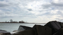 Establishing shot of Lake Erie Inlet from wave breaker boulders Stock Footage