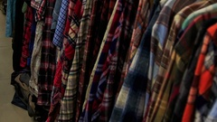 View of Racks with Colorful Women Clothes in Shop Stock Footage