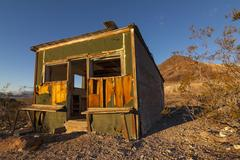 Old abandoned shack at Rhyolite Ghost Town in the Nevada Desert in early mo.. Stock Photos