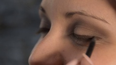 Applying eyeliner Stock Footage