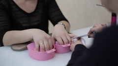Woman getting a manicure at nail salon Stock Footage