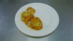 Decoration of the dish with hash Browns Stock Footage