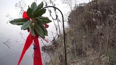 Christmas ribbon on lake bow Stock Footage