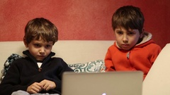 Kids watching internet media content in front of laptop computer scree. Stock Footage