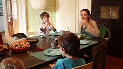 Mother and kids eating breakfast together in the morning. Stock Footage