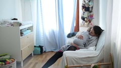 Mother and baby together about to go to sleep during afternoon siesta Stock Footage