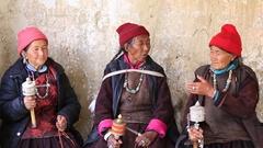 Women during Tsam mystery dance in Buddhist festival at Lamayuru, Ladakh, India Stock Footage