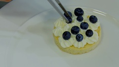 Spread blueberries on the cream Stock Footage